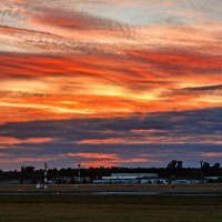 Закат над немецким аэропортом. Из самолёта. :: Ростислав Бычков
