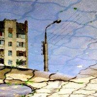 Город в отражении после ливня :: Александр Прокудин