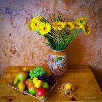 Герберы в вазе, фрукты и свеча :: Nina Yudicheva