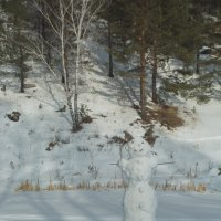 Снеговичка улыбается Весне. :: Михаил Полыгалов