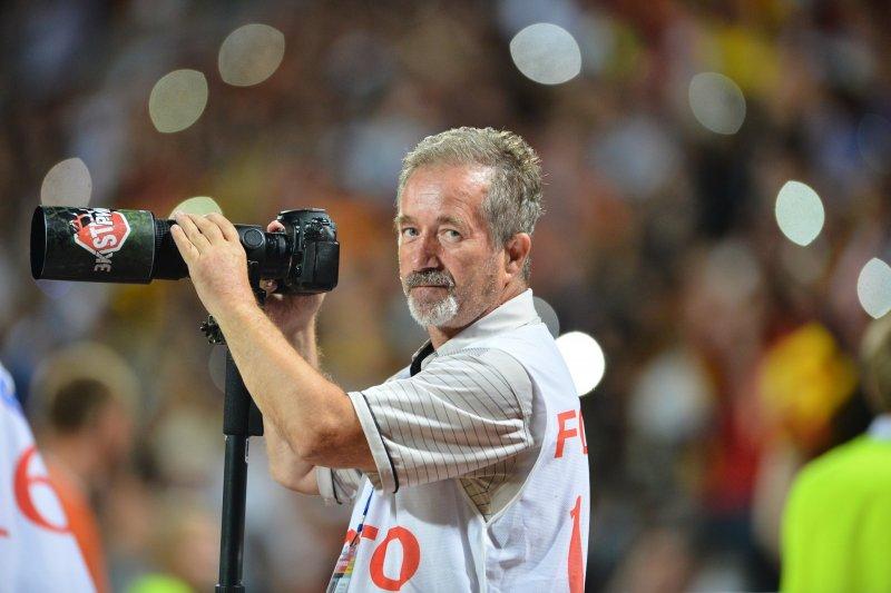 Фотограф за работой на спортивном событии