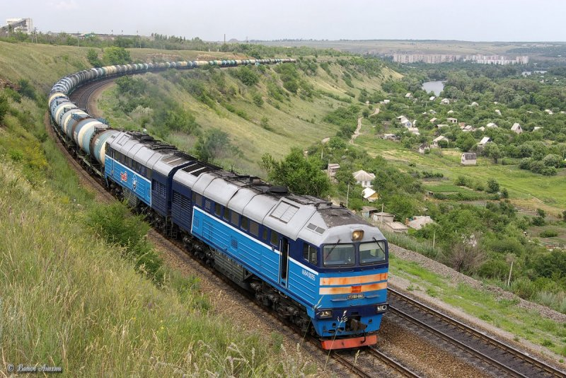 Diesel locomotive 2TE116U-0002 with train near Bel